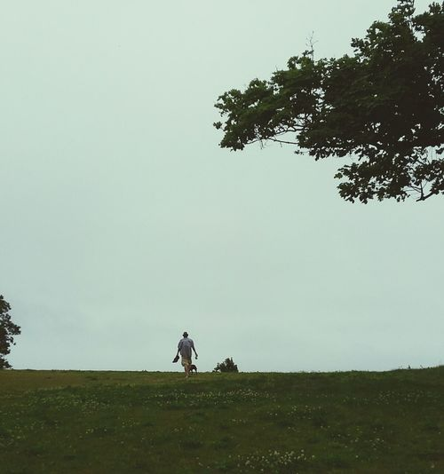 Tree Field Landscape Outdoors Nature One Person One Man Only Tranquility Outdoor Life Man And Dog Best Freind
