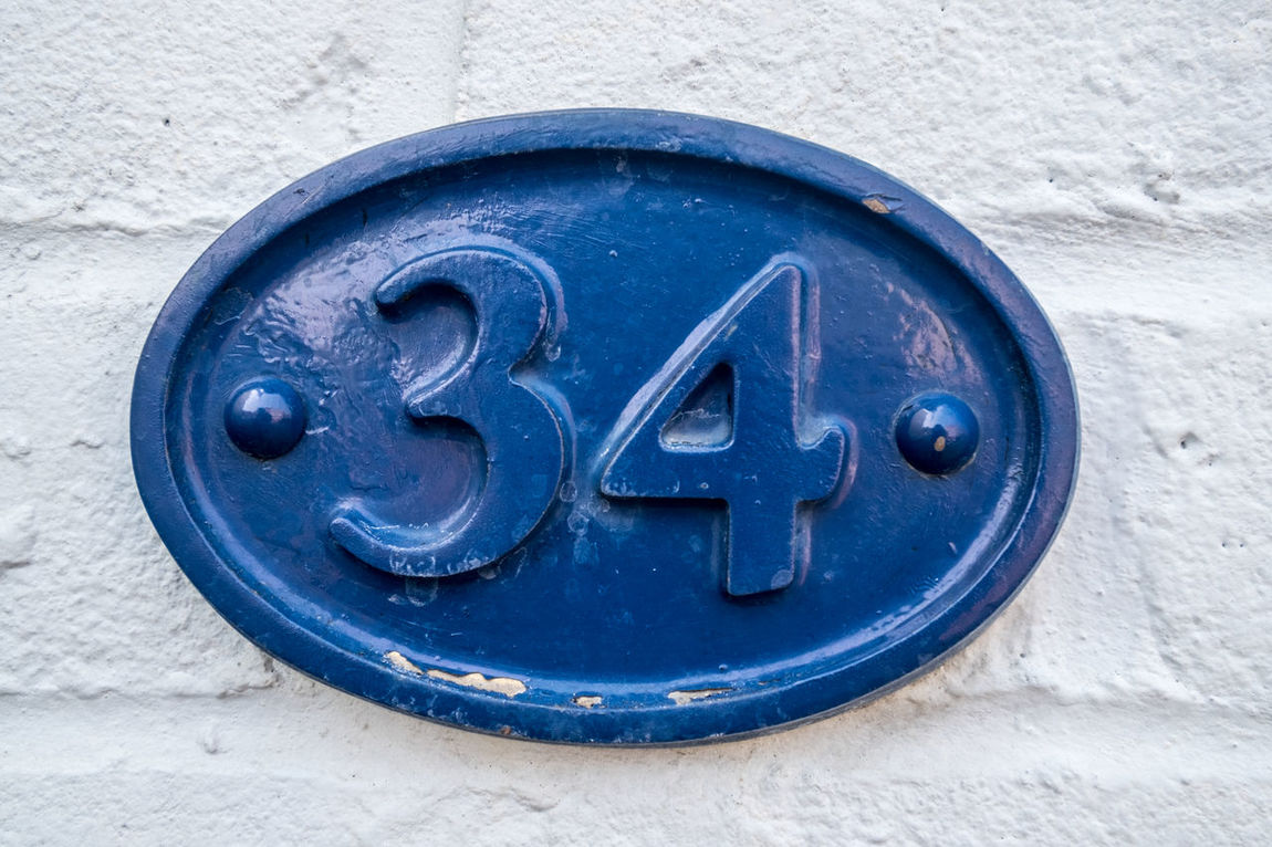 house number 34 34 340 HS Blue Circle Close-up Day Four Geometric Shape House Number Man Made Object Outdoors Thirty Thirty Four Typography