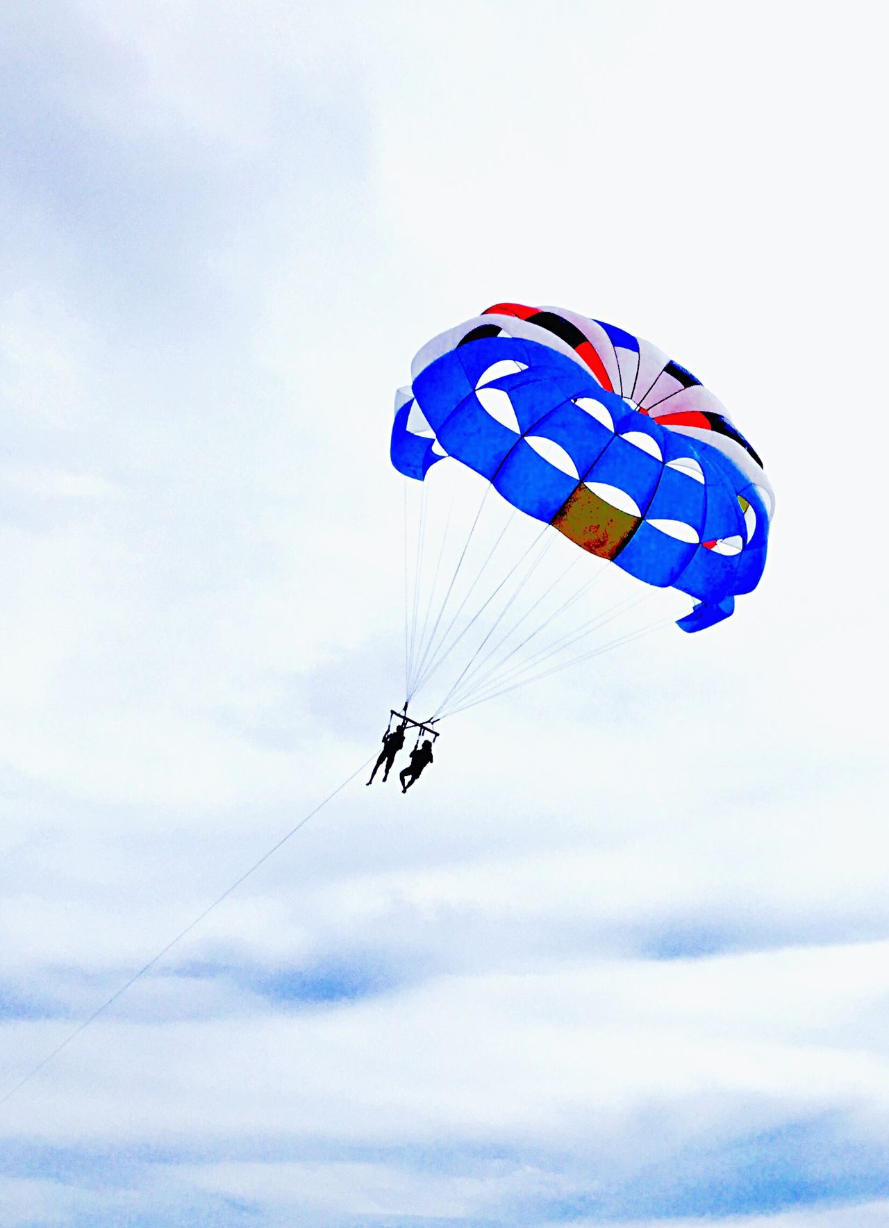 The Color Of Sport Leisure Activity Flying Mid-air Paragliding Lifestyles Adventure Parasailing BLow Angle Viewable person] Bright Colors low angle vieParachutetSkykExtreme SportstFunuCloud - SkykEnjoymentnDayaSkydivingnBlueuOutdoorsrWeekend ActivitieseVacationsns
