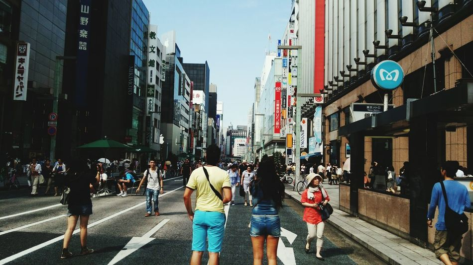 Streetphotography Ginza Tokyo Japan , Pedestrian Street on holiday City Life Day EyeEmNewHere Japan Photography Real People City Street Cityscape 銀座 People EyeEm Selects From My Point Of View Outdoors