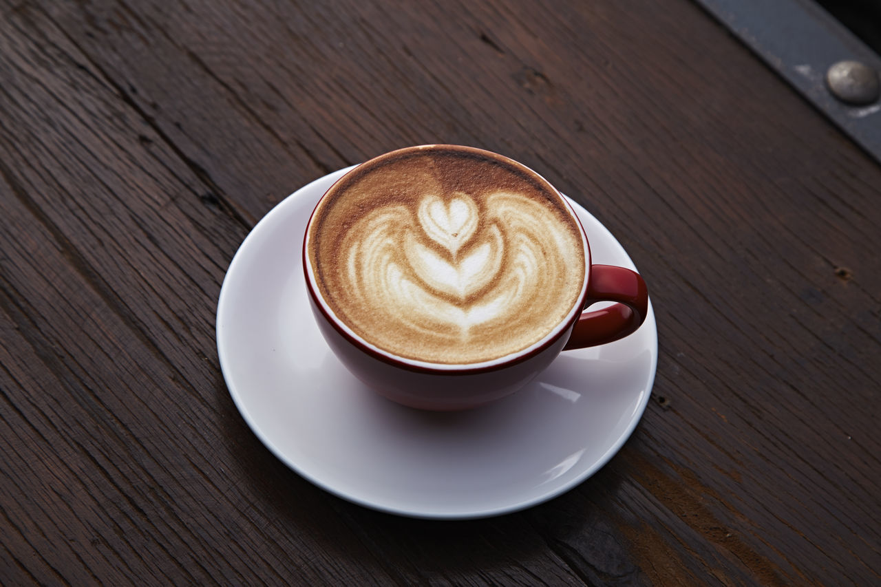 table, coffee cup, drink, frothy drink, refreshment, high angle view, coffee - drink, food and drink, saucer, shape, no people, wood - material, froth art, close-up, indoors, cappuccino, freshness, day