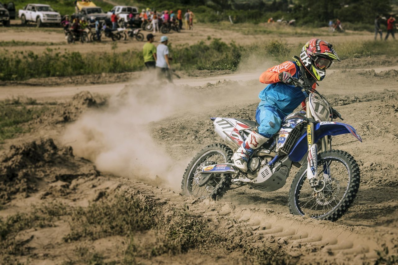 motorcycle, riding, motion, motocross, transportation, adventure, speed, crash helmet, real people, sports race, helmet, headwear, risk, competition, dust, land vehicle, men, one person, mode of transport, field, extreme sports, sports helmet, day, sport, activity, outdoors, sports track, off-road vehicle, biker, one man only, sports clothing, people, competitive sport, nature, rural scene, excitement, motorsport, skill, only men, adult, stunt, adults only