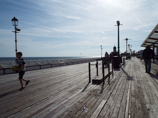 Lamp Posts People Walking  People People Around You Blackpool North Pier Tourism Silhouette Silouette & Sky Railing Sea Boy With A Football Football Fever Tourists Tourist Attraction  Summer 2016 Summertime The Essence Of Summer The Street Photographer - 2016 EyeEm Awards North Pier Pier Yellow Football Clouds And Sky People Of The Oceans People And Places