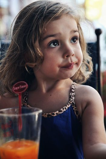 Can't resist an apricot juice !! Portrait Photography Children Photography Children Only Elementary Age Child One Girl Only Vacations Summer Outdoors Fruit Juice Apricot Juice Jus De Fruit Jus D'abricot