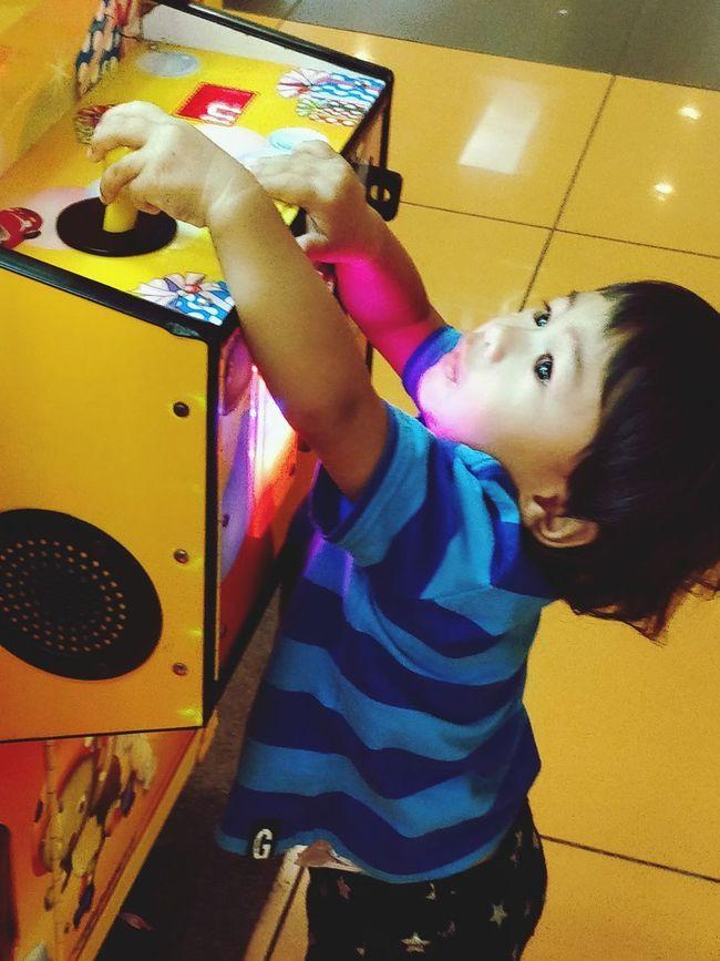 EyeEmNewHere Child Photography Arcade Reach Play