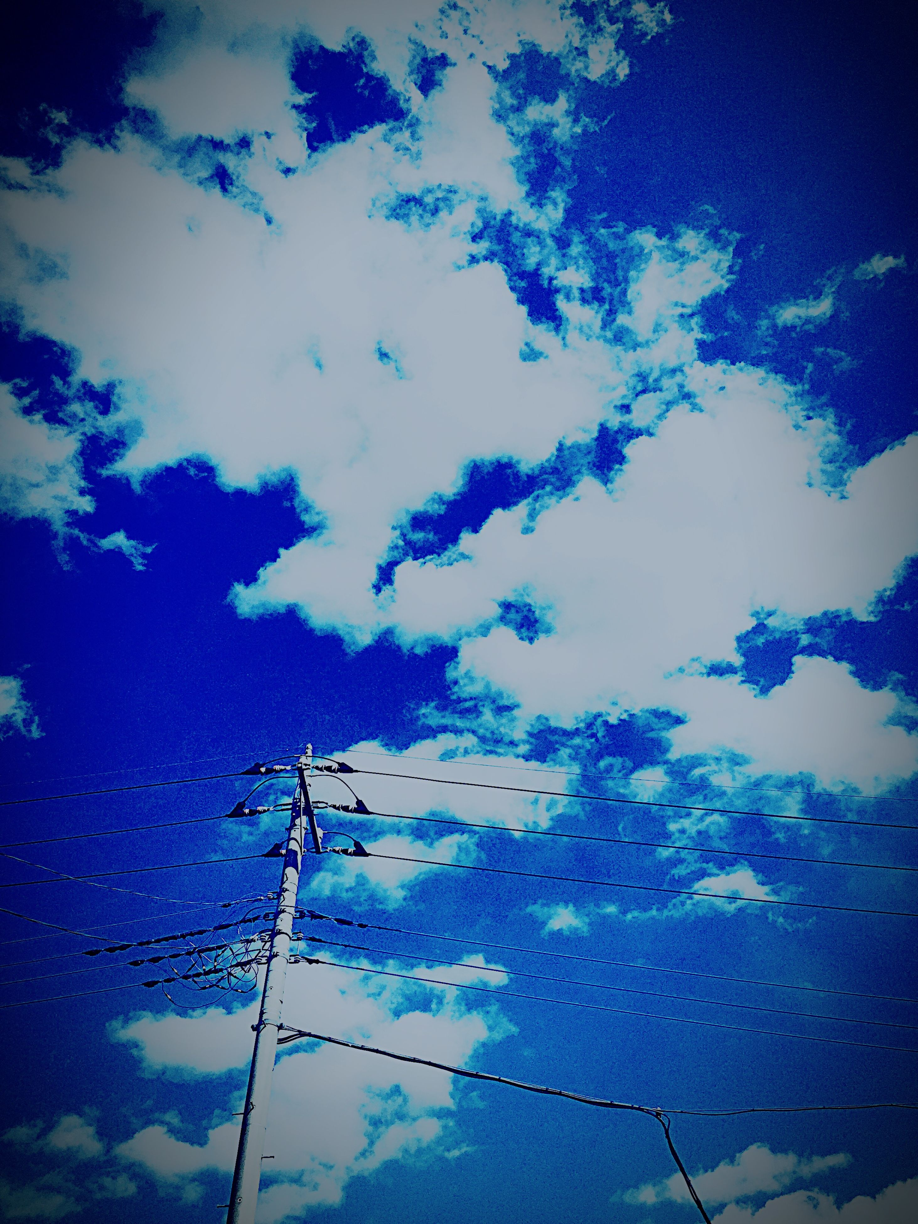low angle view, sky, power line, blue, silhouette, electricity, electricity pylon, power supply, cloud - sky, cable, connection, technology, fuel and power generation, dusk, cloud, cloudy, nature, outdoors, lighting equipment, no people
