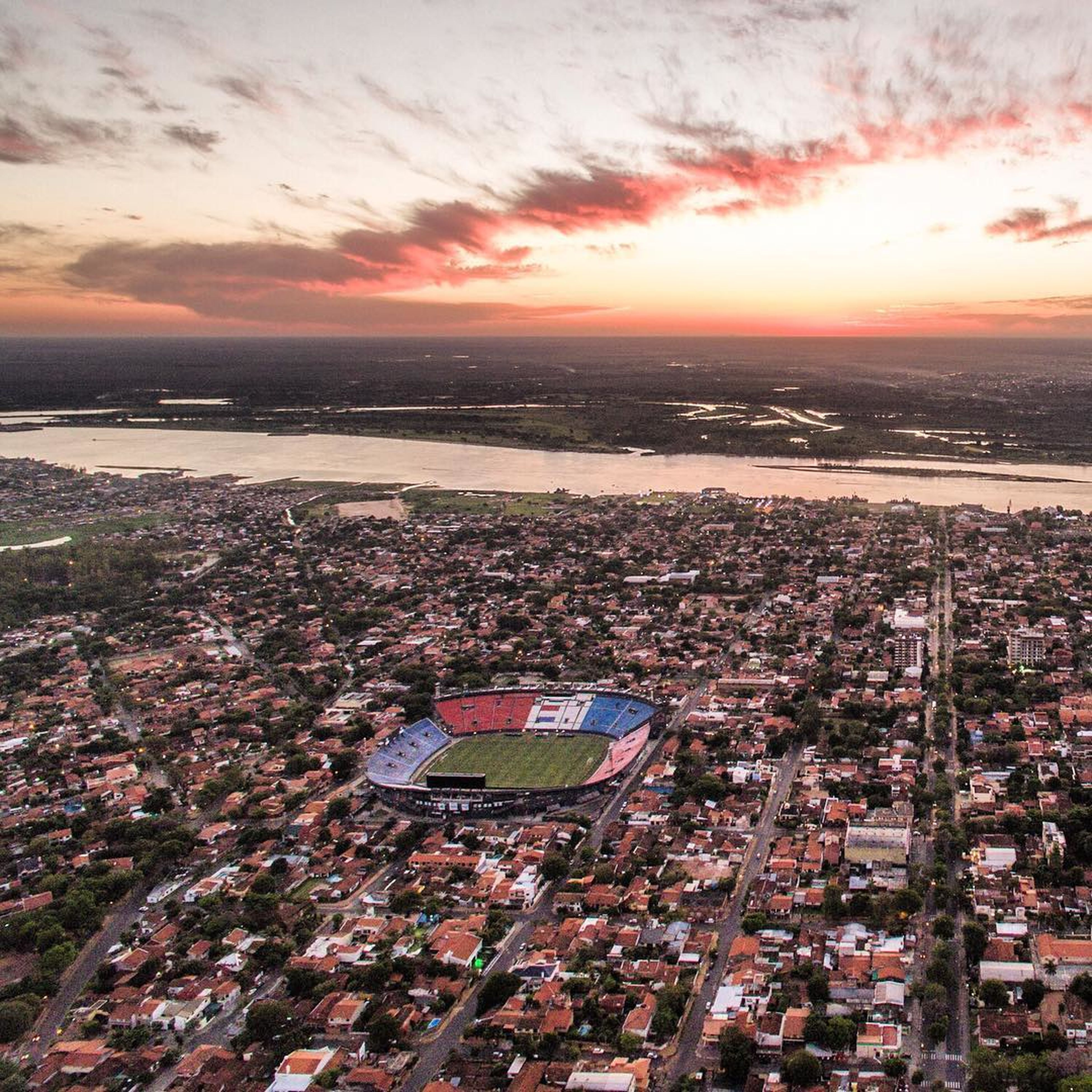 aerial view, cloud - sky, sunset, high angle view, sky, cityscape, outdoors, city, no people, growth, scenics, water, urban skyline, architecture, nature, stadium, day