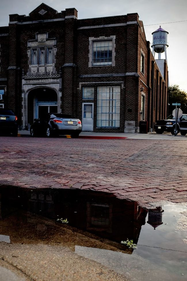 Photo essay, a day in the life. August 24, 2016 Milligan Nebraska 35mm Camera A Day In The Life Architecture Architecture Brick Building Building Exterior Camera Work Everyday Lives Eye For Photography Eye4photography  EyeEm Best Shots EyeEm Gallery EyeEmBestPics Eyeemphoto Fine Art Photography FujiX100S Photo Essay Puddle Reflection Road Small Town Stories Small Town USA Storytelling Street Streetphotography