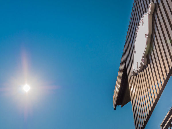Blue Bright Clear Sky Day Eaves Flare High Section Hotel Lathe Low Angle View Nature No People Outdoors Part Of Ray Reflection Shine Signboard Sky Summer Sun Sunbeam Sunlight Sunny TAB