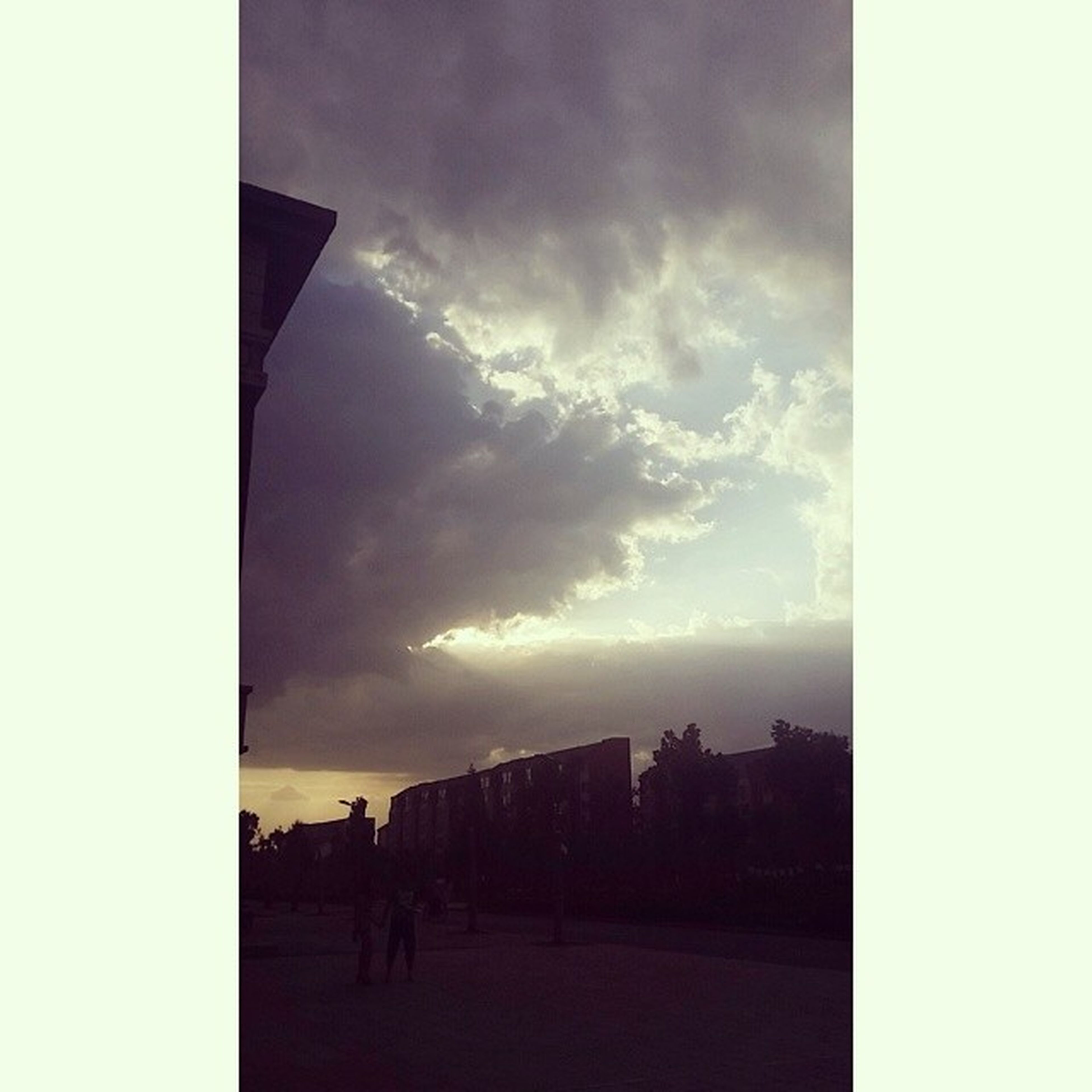 sky, cloud - sky, transfer print, cloudy, auto post production filter, built structure, lifestyles, men, silhouette, architecture, cloud, building exterior, leisure activity, weather, person, nature, large group of people, city, scenics
