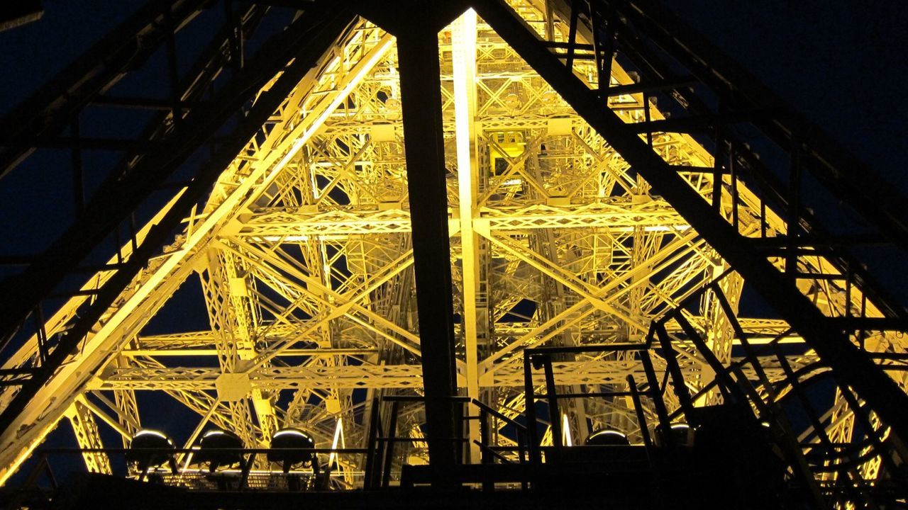 Low Angle View Of Illuminated Eiffel Tower