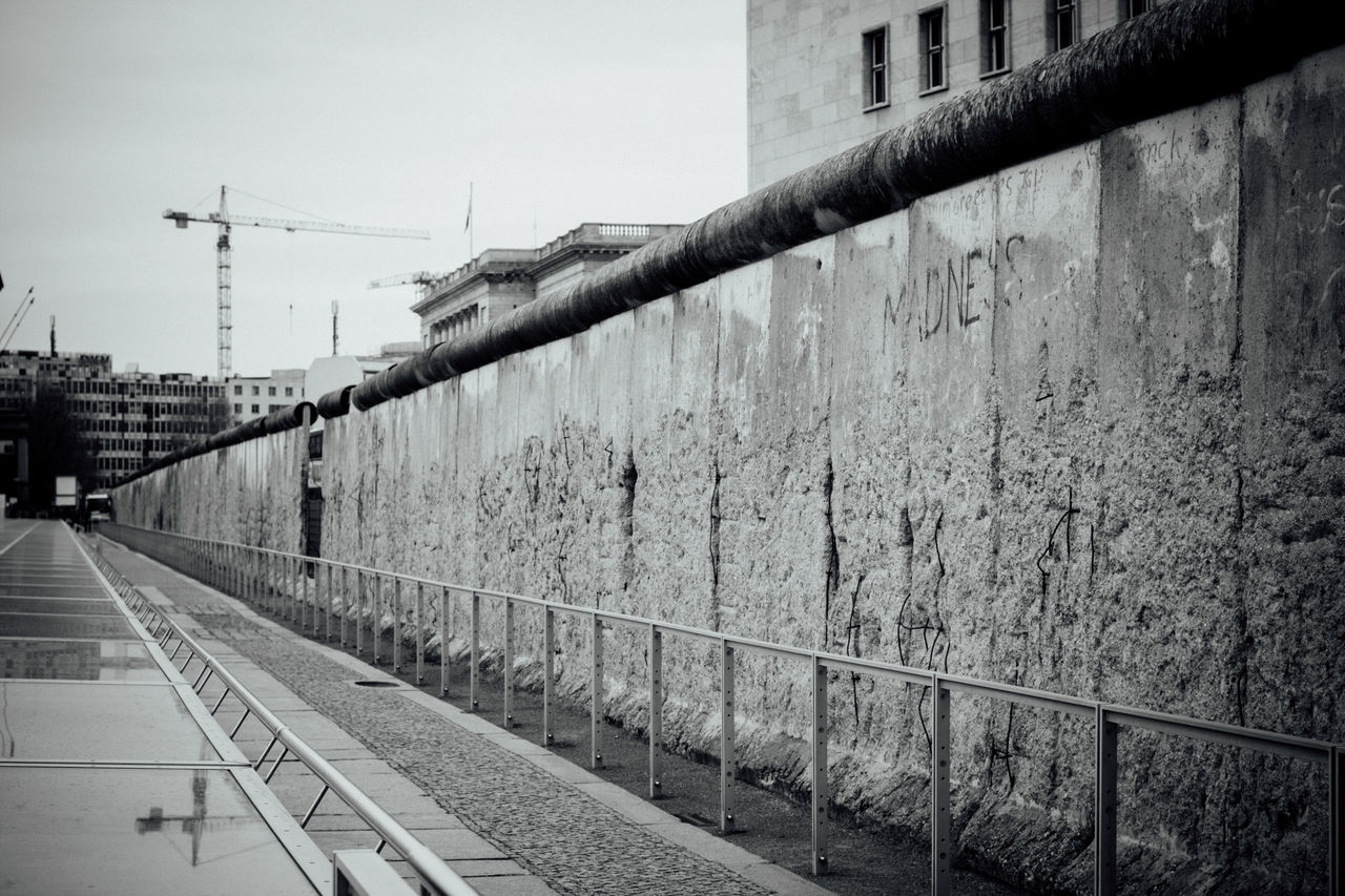 Architecture Berlin Wall Black And White Built Structure City Day Diminishing Perspective Historic History Narrow No People Outdoors Tall - High Vanishing Point Wall