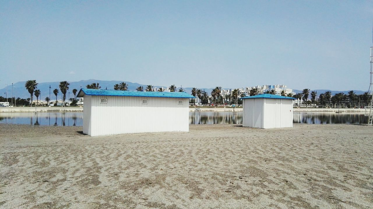sand, beach, clear sky, copy space, day, outdoors, sky, built structure, nature, blue, no people, architecture