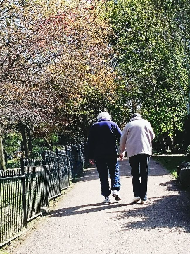 Older Couple Love Is... Walk In The Park Spring Togetherness