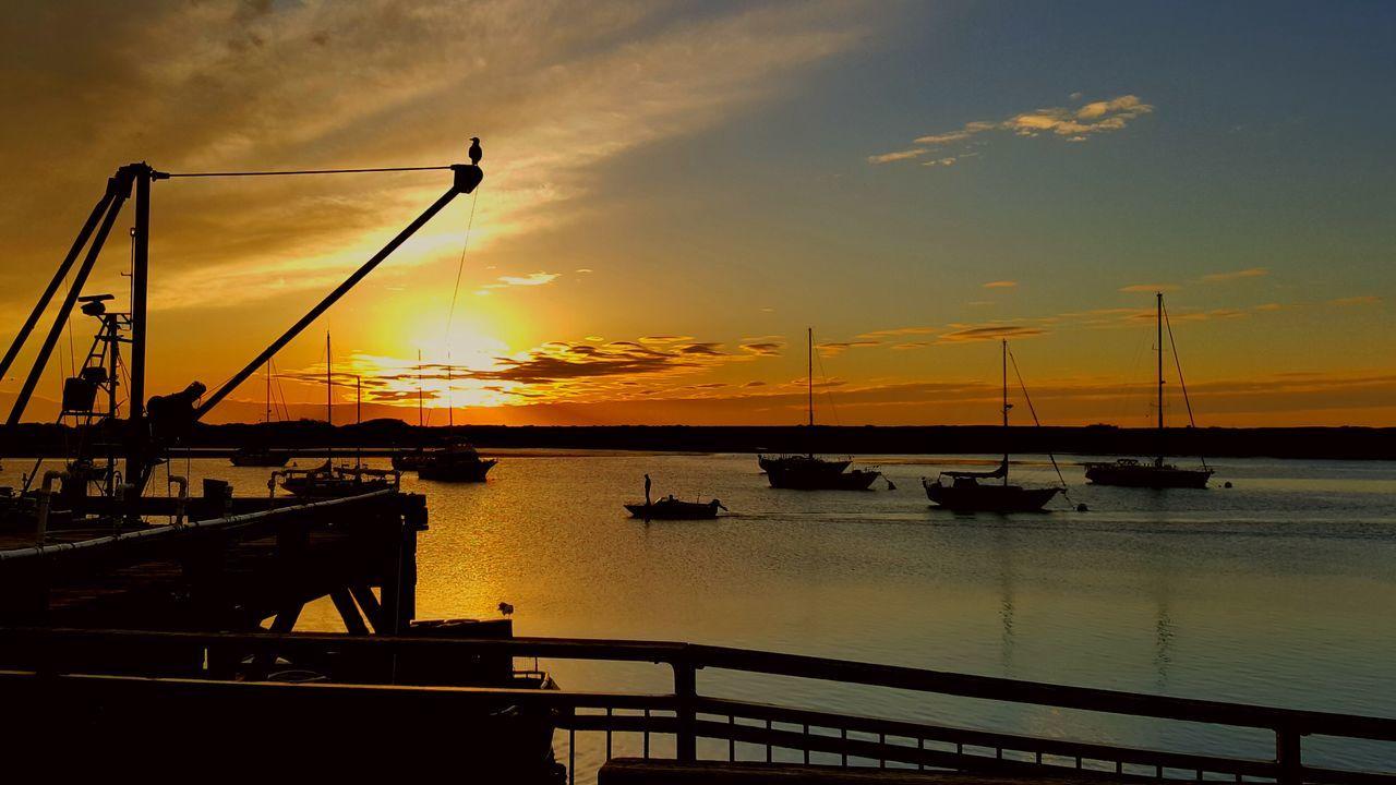 Sunset Silhouette Sea And Sky Sea Orange Boats Multi Colored Built Structure Sky Scenics Harbor Street Light