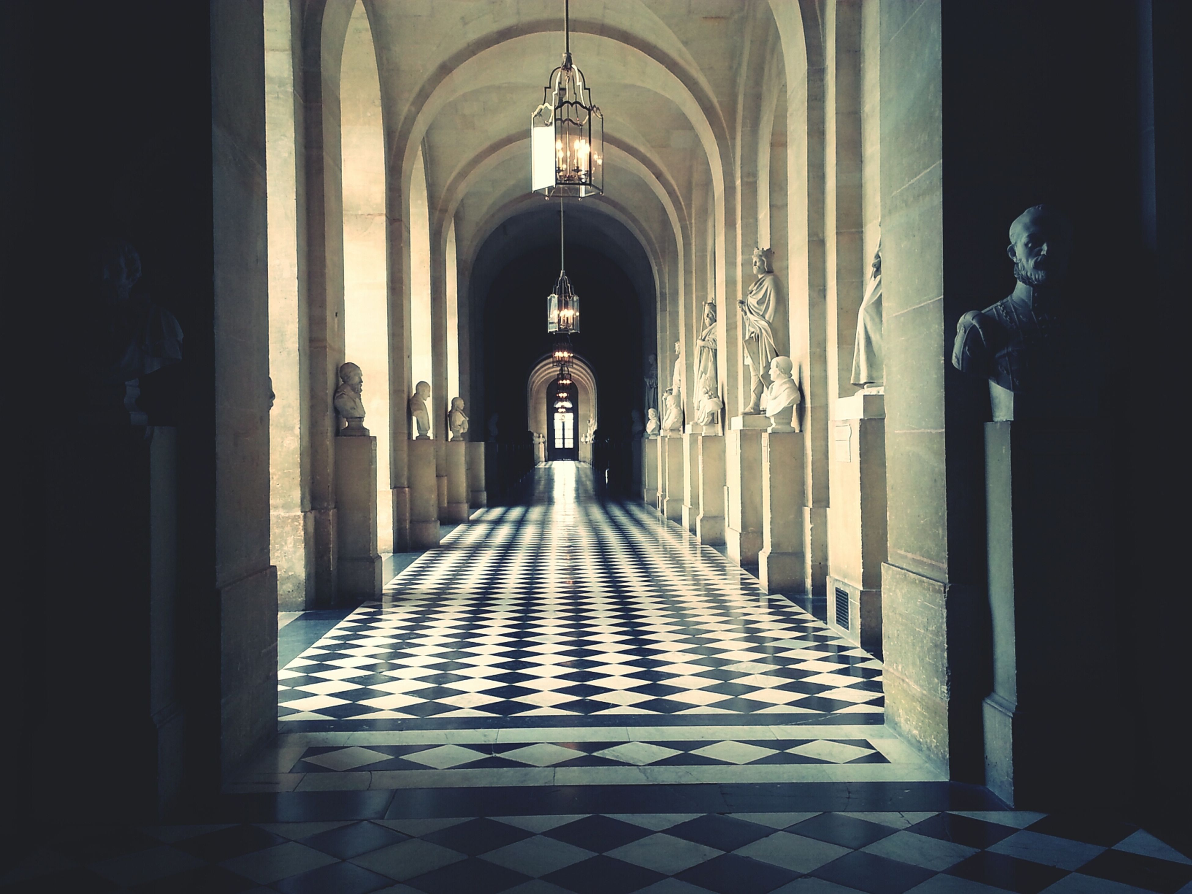 indoors, corridor, architecture, arch, the way forward, religion, place of worship, built structure, church, spirituality, architectural column, diminishing perspective, colonnade, history, in a row, column, flooring, historic