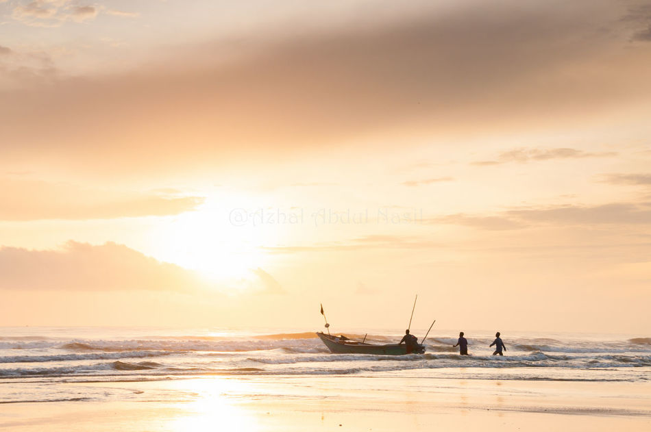 Fisherman going fishing with sunrise background Outdoors Scenics Sunrise Fisherman Malaysia Pahang, Malaysia Beserah Man Sillhouette Sea Boat Orange Village Life Working Sunset Wave Morning Beach