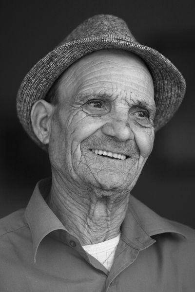 Uniqueness One Man Only Portrait Senior Adult One Person One Senior Man Only Headshot Hat Senior Men Smiling People Retirement Formal Portrait Wrinkles Mature Adult Oldness Wrinkle Of Life Wrinkles Of A Long Life Lived Real People Fine Art Fisherman Old Fisherman Puglia Italy