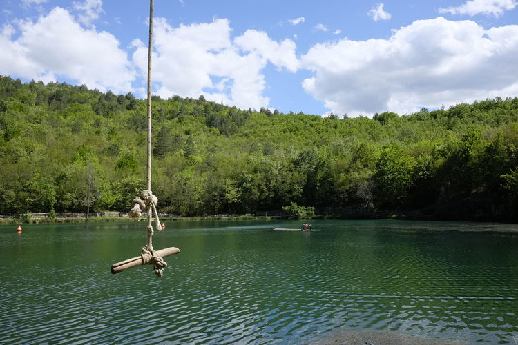 Rope for jumping into the lake Beauty In Nature Cloud - Sky Day Green Color Jumping Lake Nature No People Outdoors River Rope Scenics Sinizzo Sky Swinging Tranquil Scene Tranquility Tree Water Waterfront