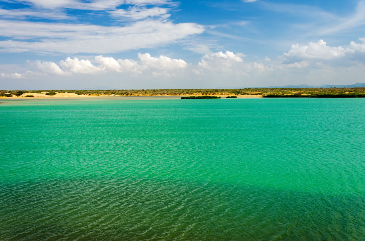 Green sea and blue sky in La Guajira, Colombia Beach Beautiful Calm Caribbean Coast Coastline Colombia Day Hot Idyllic La Guajira La Guajira Colombia Landscape Nature Nobody Ocean Outdoor Outdoors Paradise Punta Gallinas Relax Riohacha Sand Travel Vibrant