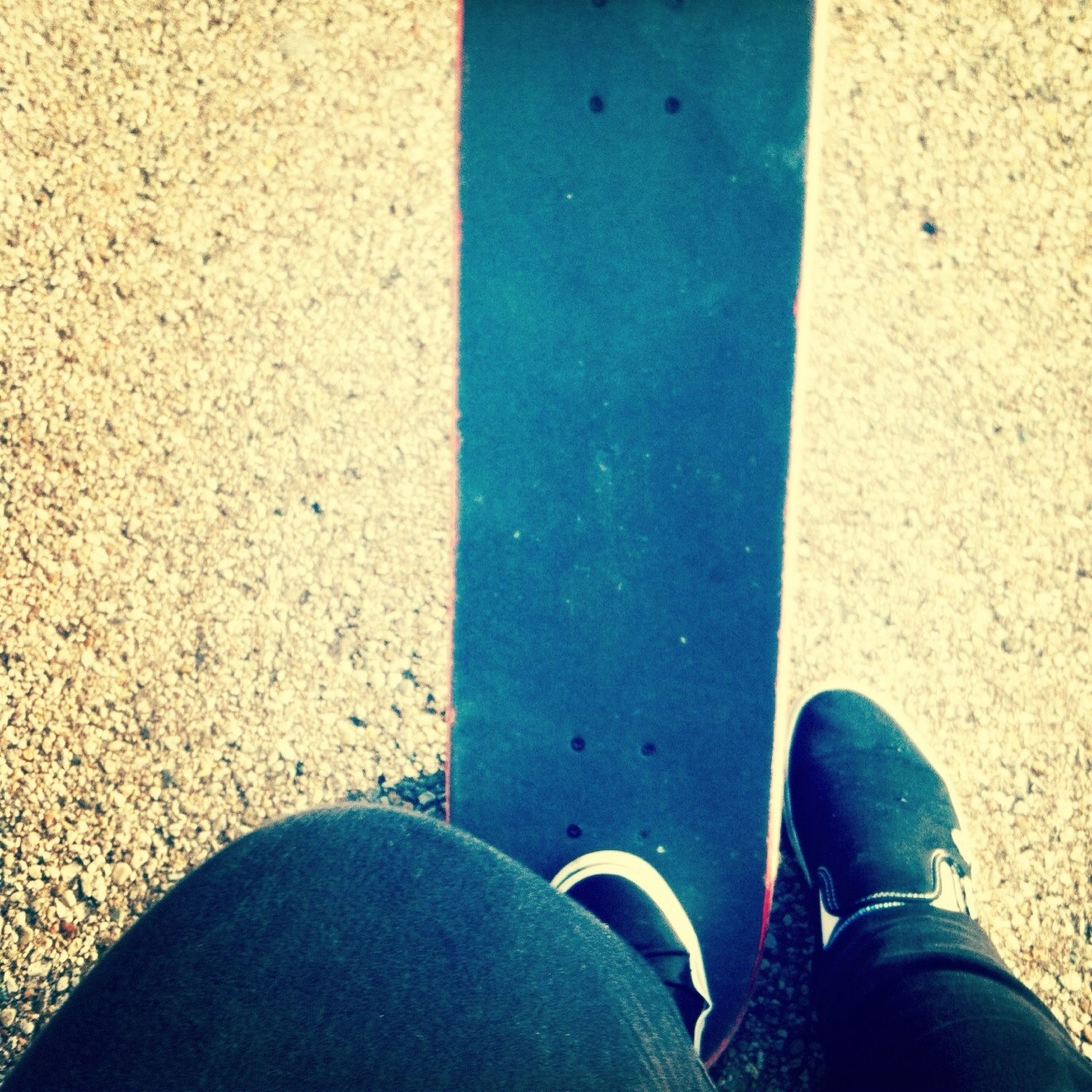 low section, person, shoe, personal perspective, footwear, human foot, standing, lifestyles, men, high angle view, leisure activity, street, jeans, blue, unrecognizable person, part of, day
