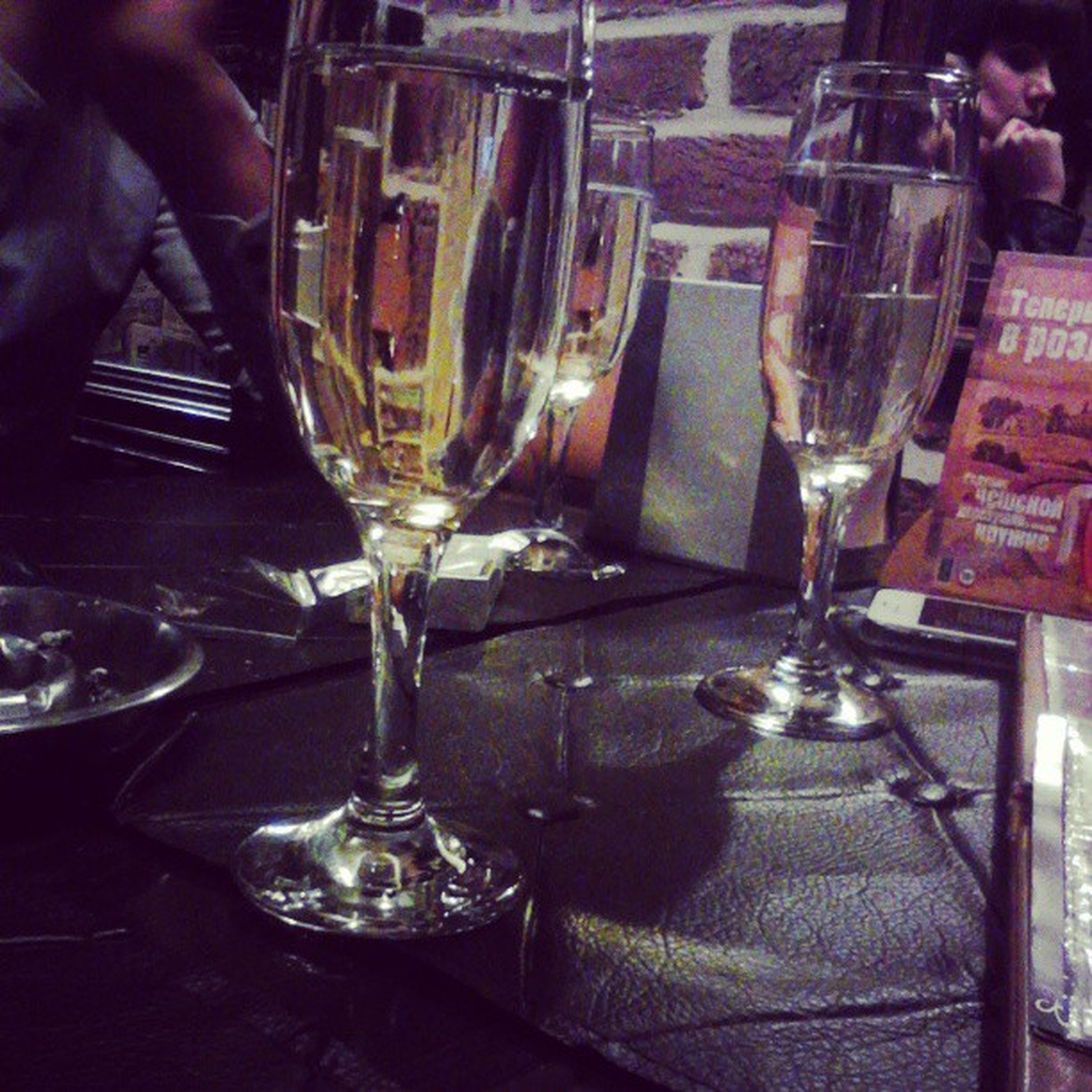 indoors, food and drink, drink, drinking glass, table, refreshment, person, wineglass, alcohol, glass - material, restaurant, part of, freshness, men, wine, lifestyles, midsection