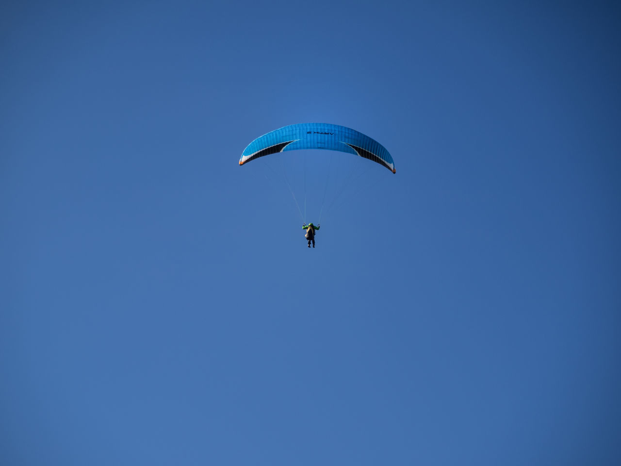 Into the blue. Adventure Blue Blue Sky Carefree Clear Sky Day Distant Exhilaration Extreme Sports Flying Gliding Leisure Activity Low Angle View Mid-air Nature Parachute Paragliding Scenics Sky Skydiving Tranquility Transportation