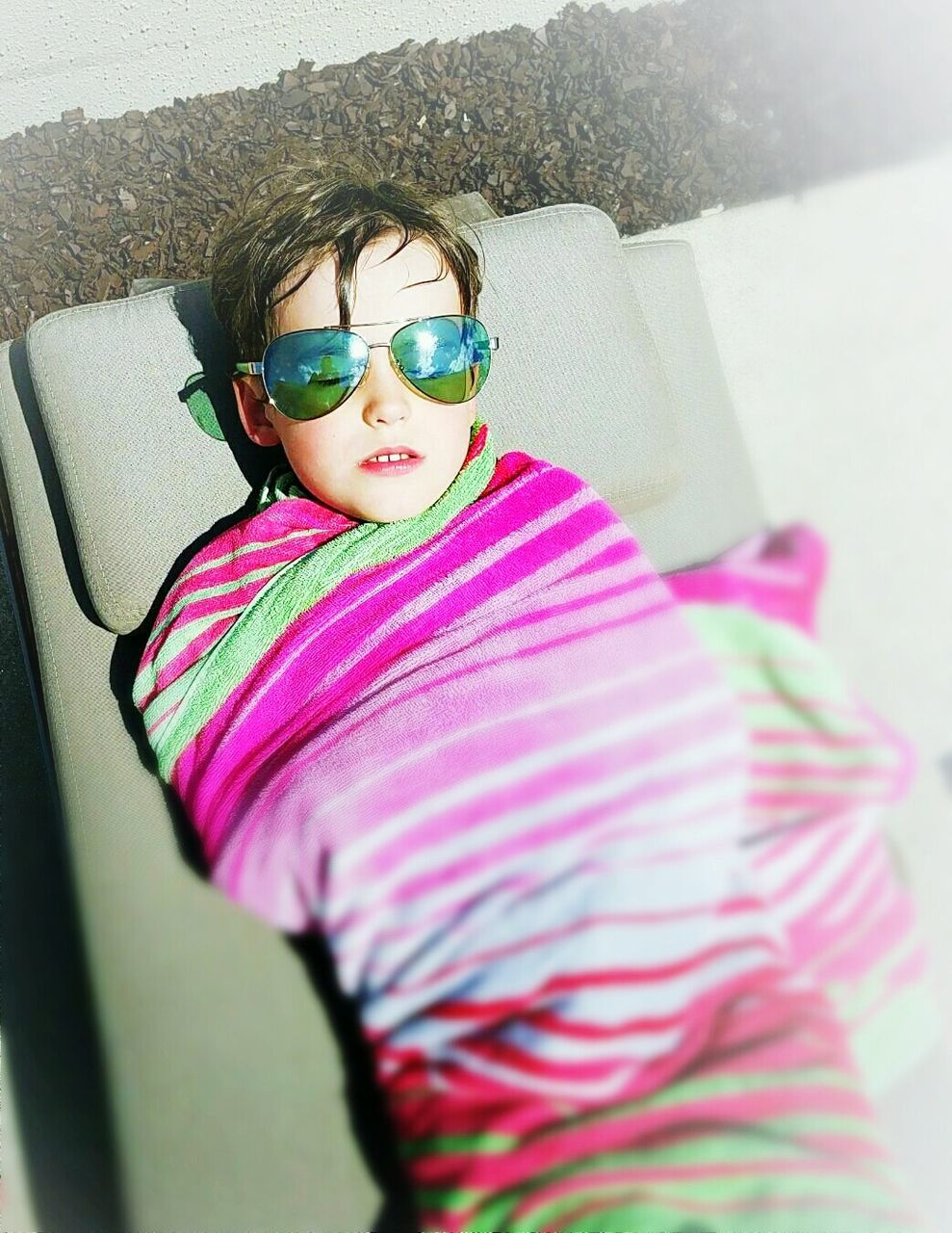 sunglasses, childhood, elementary age, girls, eyeglasses, one person, high angle view, real people, leisure activity, lifestyles, boys, relaxation, child, day, outdoors, people