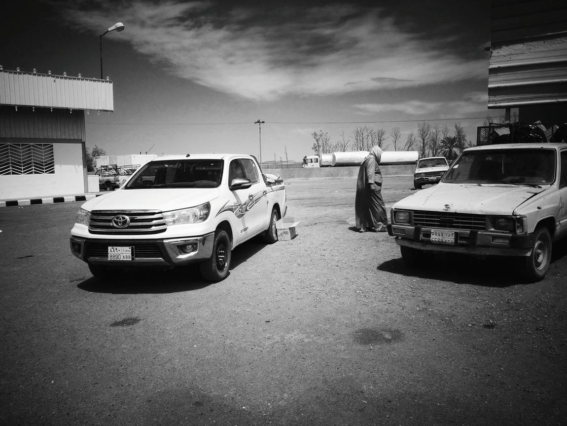 Journey of souls. Car Transportation Mode Of Transport Land Vehicle Cloud - Sky No People Peaceful View Journey Of Souls MeccaStreet Mecca Al-mukarramah Mecca Saudi Arabia Street Photography Travelphotography Travelogue Catch The Moment Traveling The World Street Life Islamiclife Journey Of Life Old Car Abandoned Car Black & White Black And White Photography