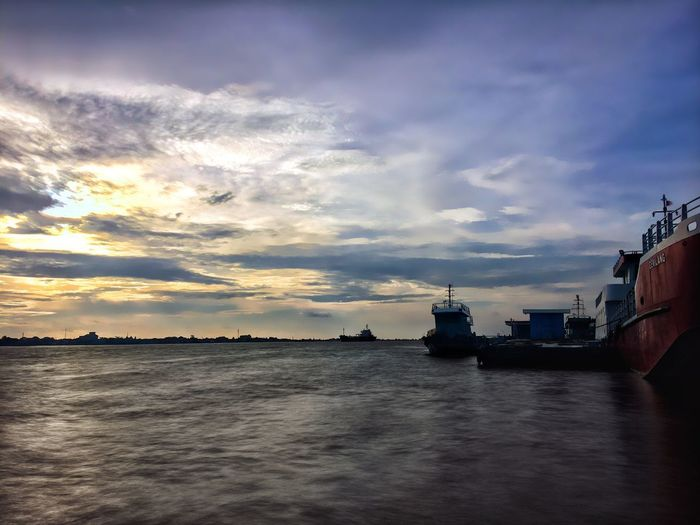 When You Try to Reach the Edge of the River IPhoneography Sky Cloud - Sky Water Nautical Vessel No People Sunset Waterfront Nature Mode Of Transport Outdoors Transportation Rippled Beauty In Nature Tranquility Scenics Horizon Over Water