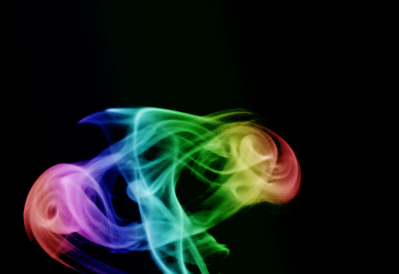 smoke - physical structure, black background, burning, motion, studio shot, green color, swirl, no people, close-up, day