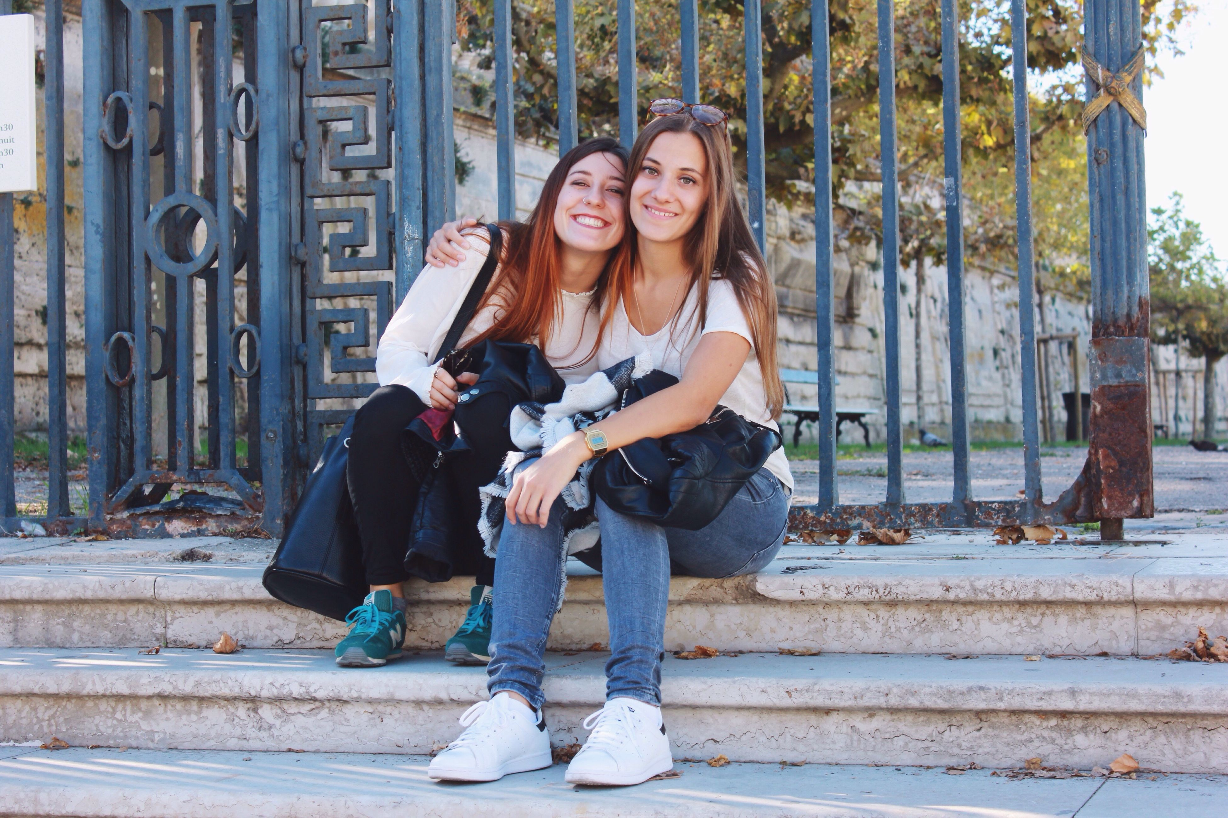 teenager, teenage girls, females, adolescence, friendship, sitting, full length, beautiful people, smiling, leisure activity, outdoors, longboard skating, people, togetherness, young adult, beauty, summer, lifestyles, happiness, women, cheerful, adult, beauty in nature, young women, beautiful woman, day, human body part