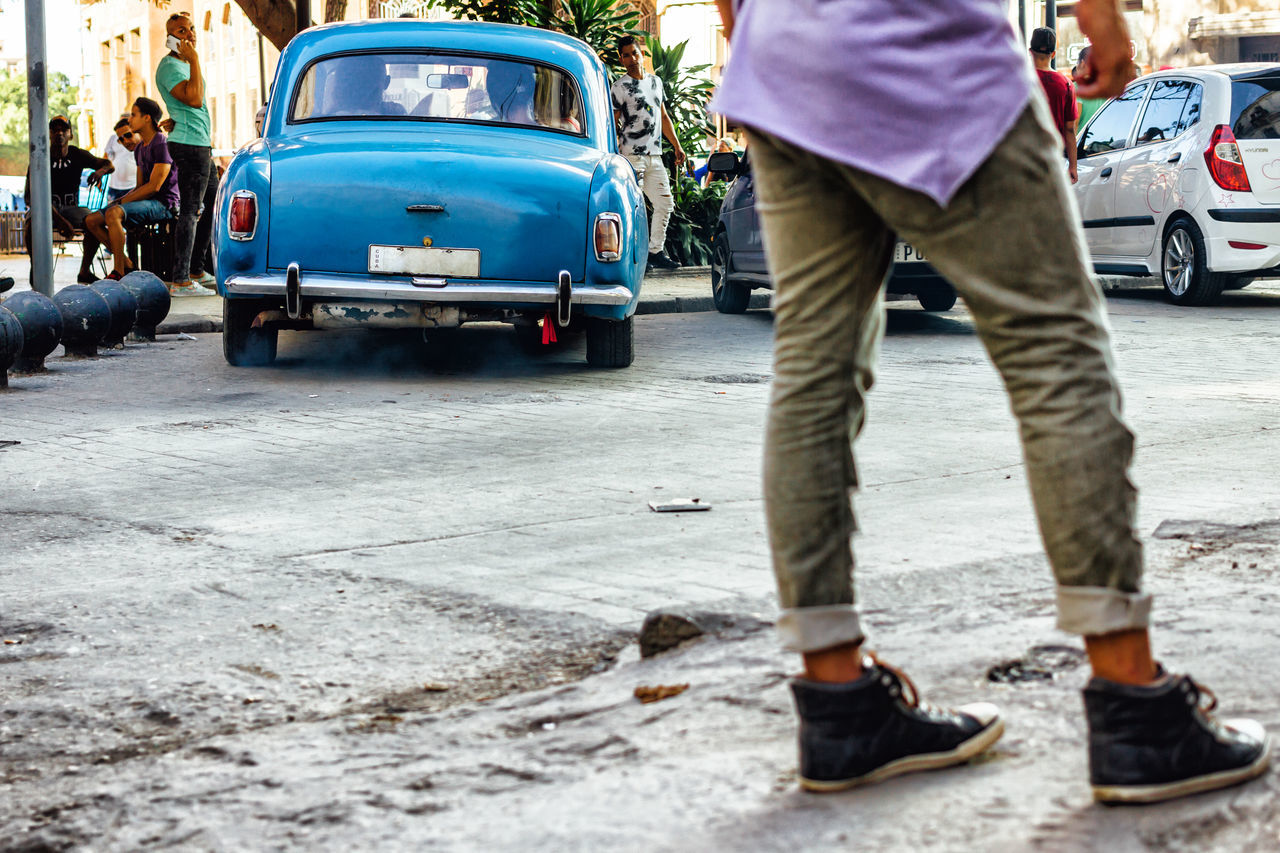 Adult Adults Only Car Casual Clothing Classic Car Cuba Collection Cuban Cuban Cars Day From My Point Of View Front View Getting Inspired Human Body Part Human Leg Low Section Old Havana Outdoors People Standing Street Streetphotography