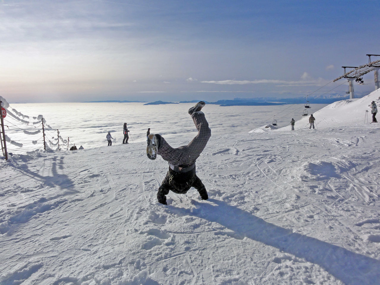 Snowboarders in action: a little acrobatics... Acrobatics  Day Extreme Sports Happy Motion Outdoors Ski Holiday Snow Snow Sports Snowboard Snowboarding Sport Travel Destinations Winter Winter Sport