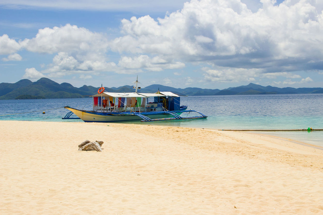 Astrology Sign Beach Beauty In Nature Blue Cloud - Sky Day El Nido El Nido, Palawan Landscape Mode Of Transport Moored Nature Nautical Vessel No People Outdoors Pedal Boat Rowboat Sand Scenics Sea Sky Tranquil Scene Tranquility Transportation Water