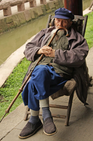 Adult Beard Cane Chinese Day Full Length Men One Person One Senior Man Only Outdoors People Real People Resting Senior Adult Senior Men Sitting Sleeping Walking Cane