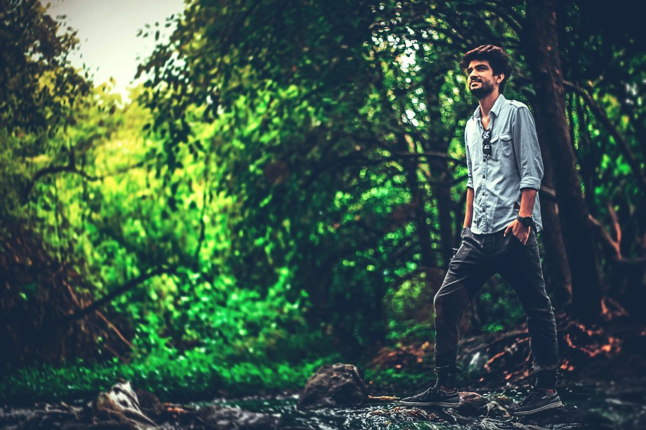 full length, casual clothing, tree, forest, one person, real people, outdoors, young adult, day, nature, people