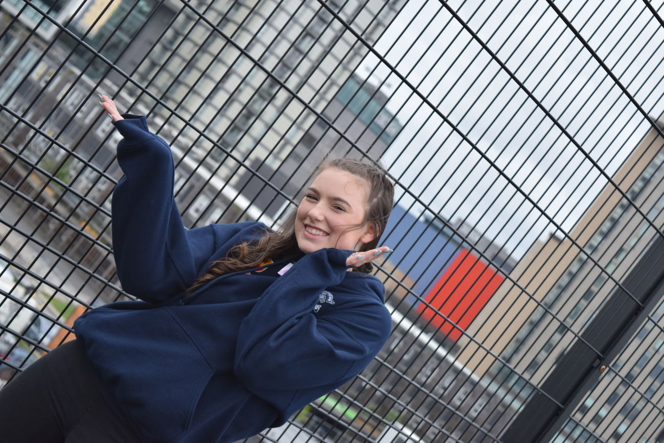 Casual Clothing Chainlink Fence Day Focus On Foreground Fun Girl Happy Leisure Activity Lifestyles Manchester Mediacityuk Outdoors Person Serious