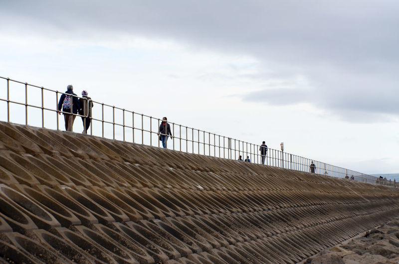 Mutton Island Promenade Sea Wall Causeway Outdoors Railing Real People Walking
