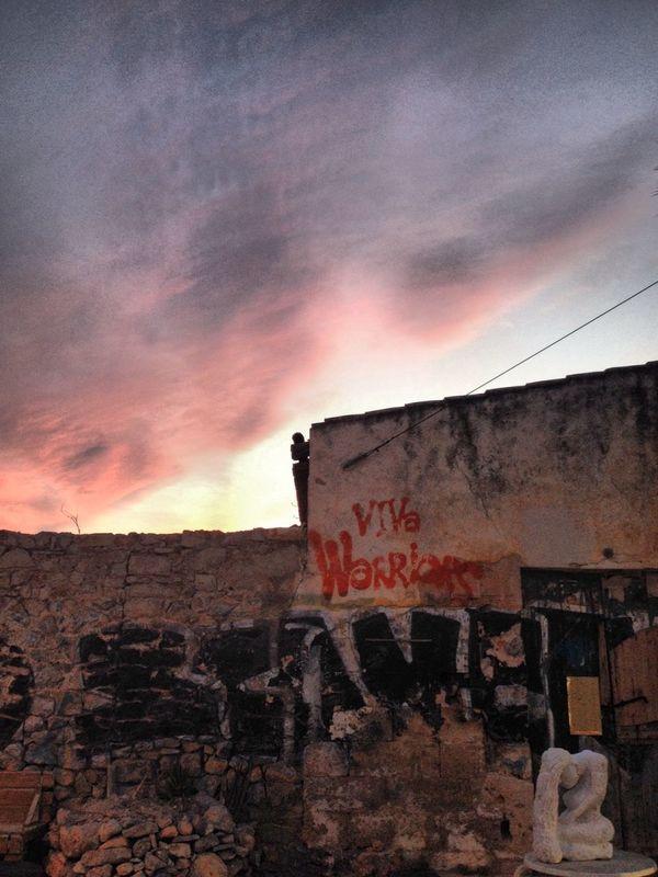 Viva Viva Warriors Sunset Pink Stone Building Graffiti Art Sculpture In The City Ibiza Town Textures & Tones Contrasts