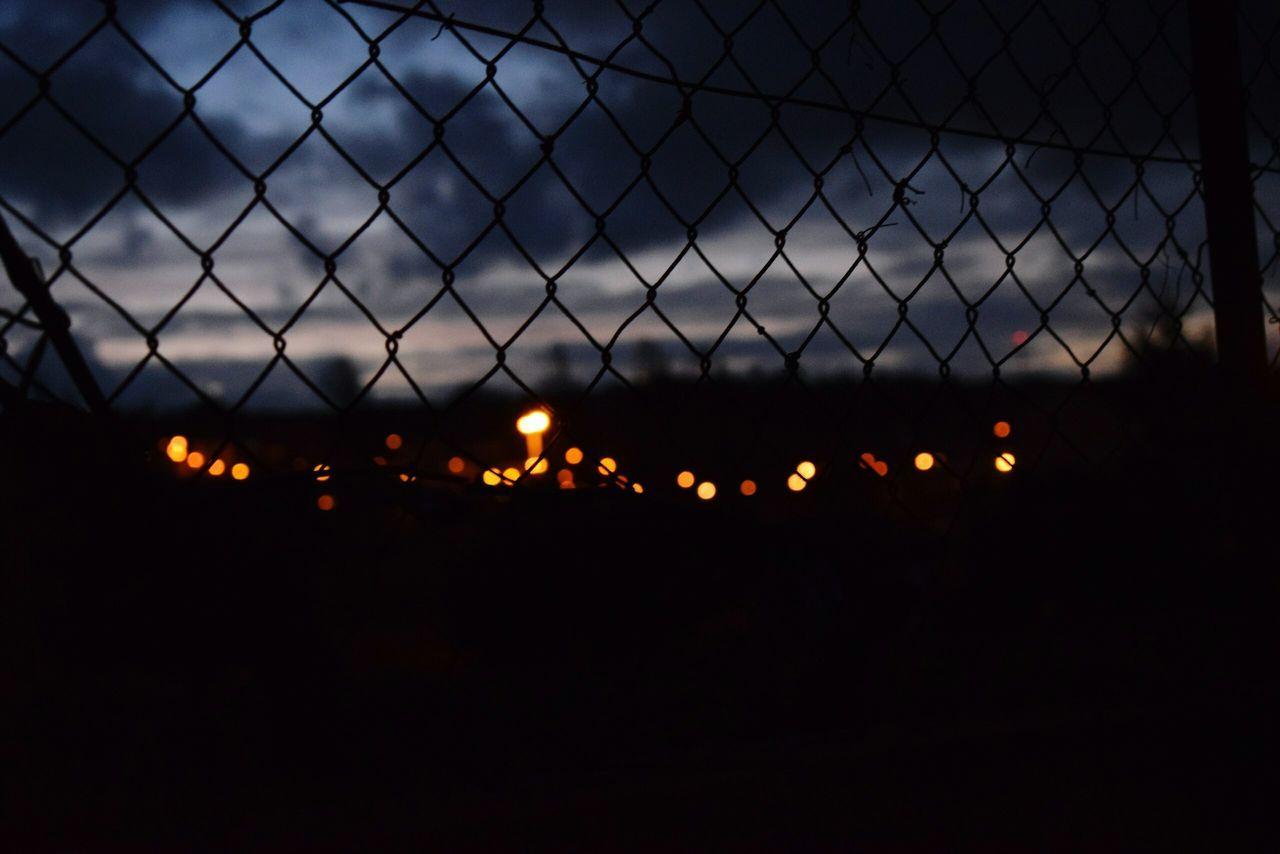 chainlink fence, illuminated, safety, protection, no people, outdoors, sky, night, sunset, close-up, nature