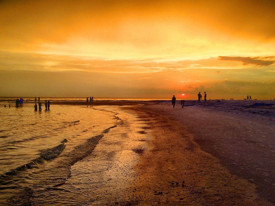 Orange sunset on Lido Key Beach in Florida. Sky Sunset Florida Sunsets Orange Tranquility Outdoors Sunny People Watching Sunset Florida Life Florida Nature Florida Clouds Florida Sunset Florida Sunset Sky Lido Key Beach Sarasota Florida Sarasota