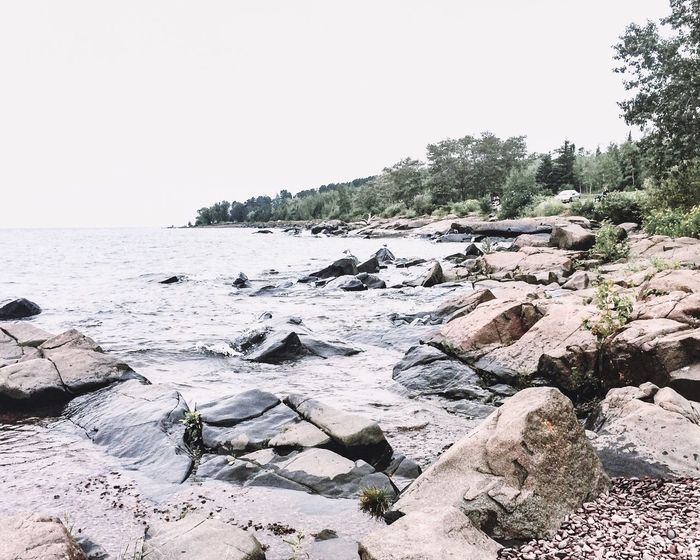 Rocks On The Shore Rocks And Water Gray Sky Gray Day. North Shore Minnesota Great Lakes Cloudy Skies Lakeshore Lake Superior North Shore Lake Superior Waves And Rocks Pine Trees Landscape_Collection Landscape_photography Landscape
