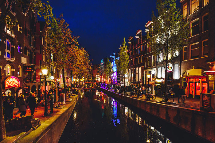 Red Light District Architecture Building Exterior Built Structure Canal City Illuminated Large Group Of People Night Outdoors People Real People Red Light District Sky Travel Destination Water Neighborhood Map
