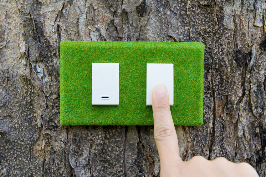 eco switch,save energy concept Switch Earth Hour Eco Power Close-up Conceptual Conceptual Photography  Day Eco Energy Eco Friendly Ecology Energy Green Color Human Body Part Human Hand Nature One Person Outdoors People Playing Power Supply Reminder Tree Tree Trunk