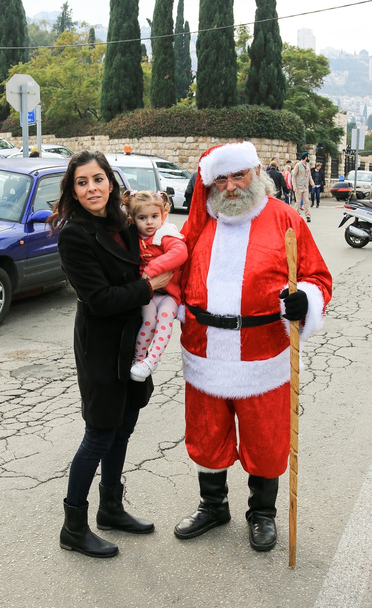 Haifa, Israel - December 17, 2016 : Santa Claus posing for photographers in the German Colony in Haifa, Israel Adult Camera Celebration Christmas City Claus Colony Day December German Haifa Happy Hat Holiday Israel Outdoors People Photographers Photography Picture Posing Santa Seasonal Standing Street