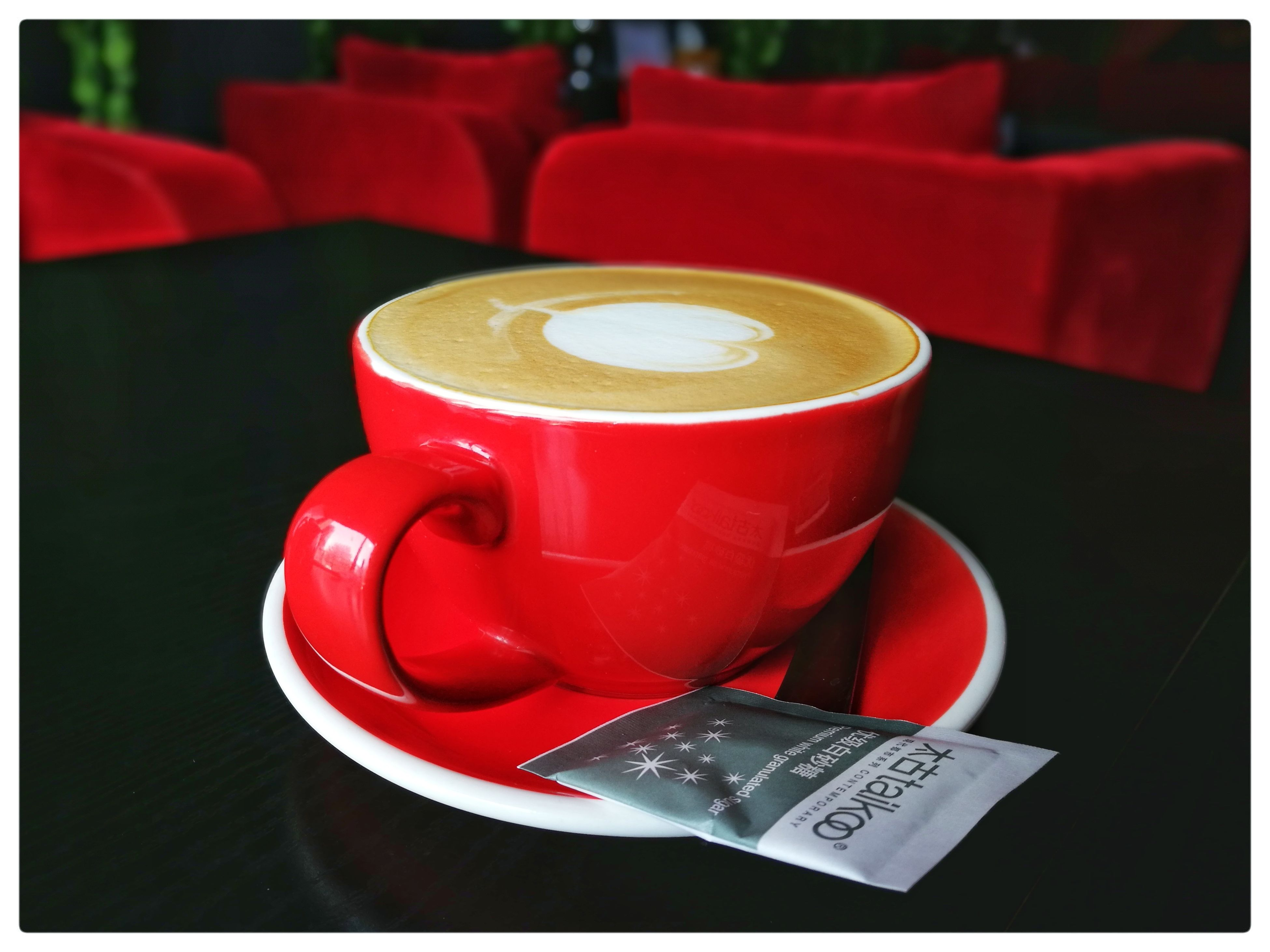 coffee cup, drink, coffee - drink, refreshment, table, food and drink, cup, saucer, indoors, cappuccino, red, cafe, no people, frothy drink, froth art, close-up, latte, freshness, day