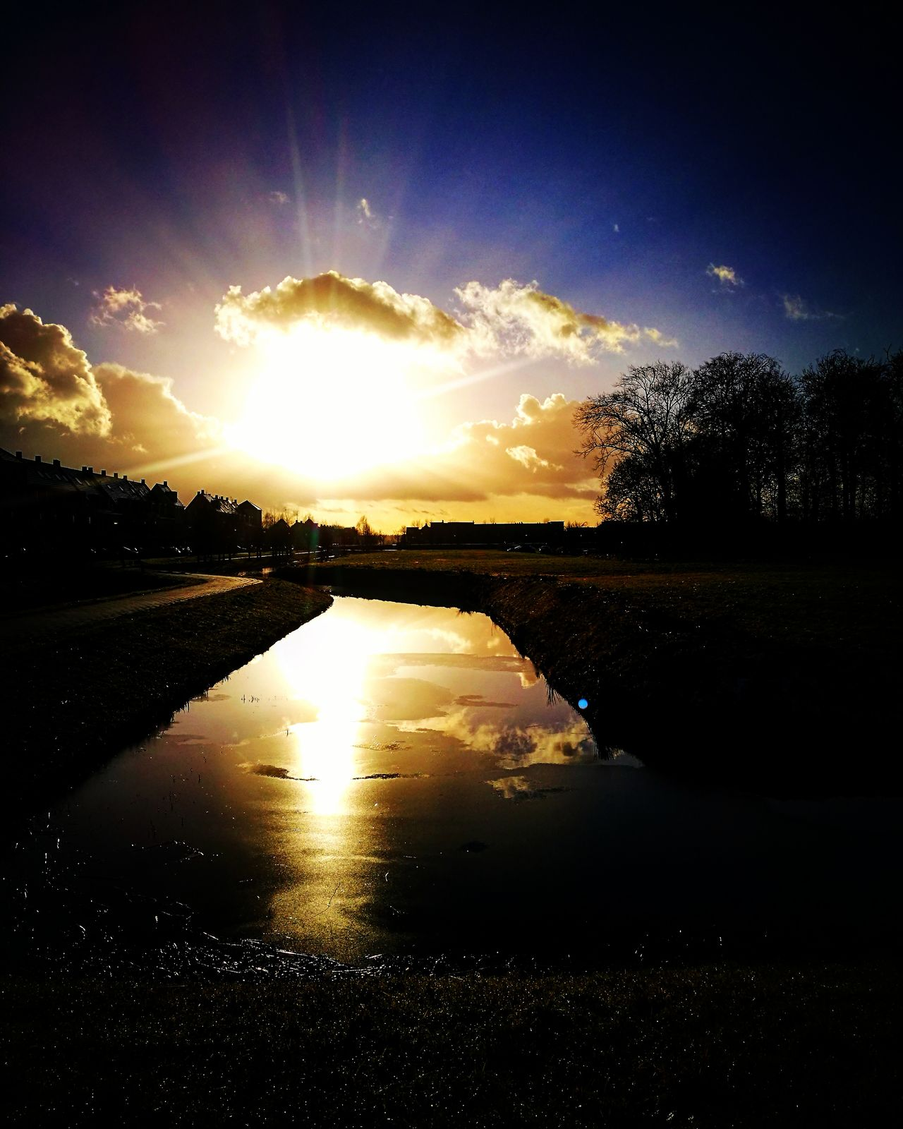 Reflection Water Nature Sky Beauty In Nature No People Day Outdoors Sun Sunlight Sunset_collection Sunshine Blue Blue Sky Cloud Cloud - Sky Clouds And Sky