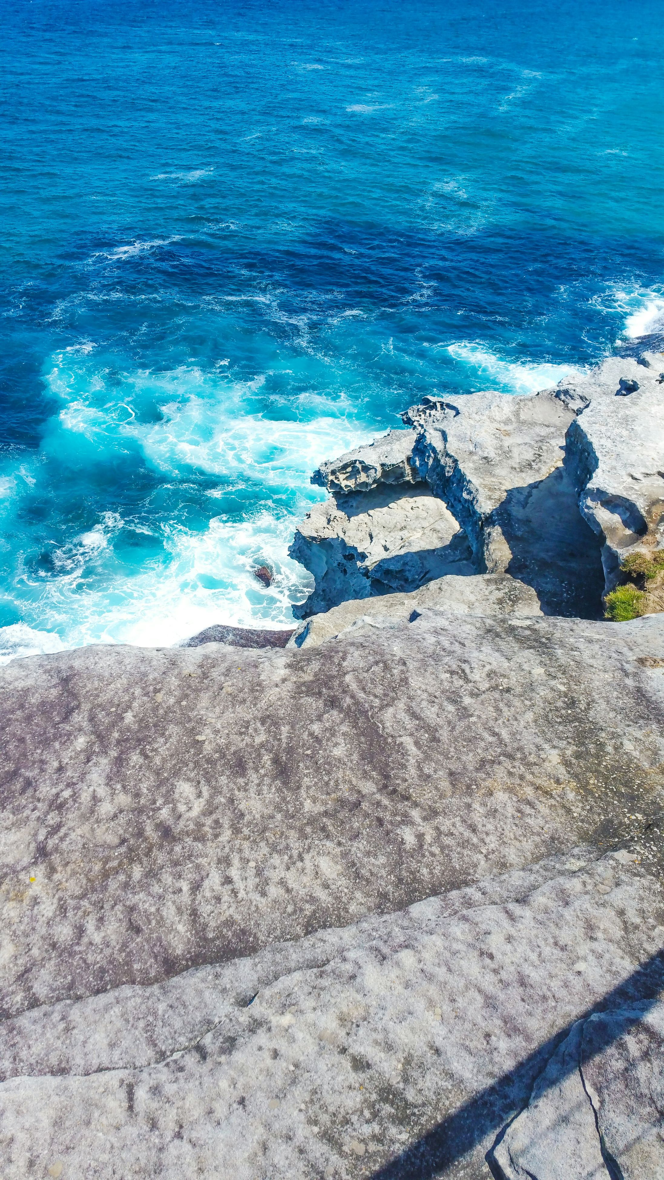 sea, water, blue, high angle view, tranquility, beauty in nature, scenics, tranquil scene, nature, beach, shore, horizon over water, coastline, wave, rock - object, surf, idyllic, day, rock formation, no people