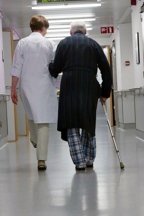 Old Man Walking Nurse Hospital Corridor Exercise Rear View Belgium